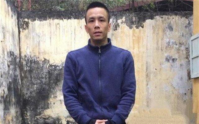 Đối tượng Lê Hồng Nam khi bị Cơ quan Công an bắt giữ (Ảnh: Từ Huy)