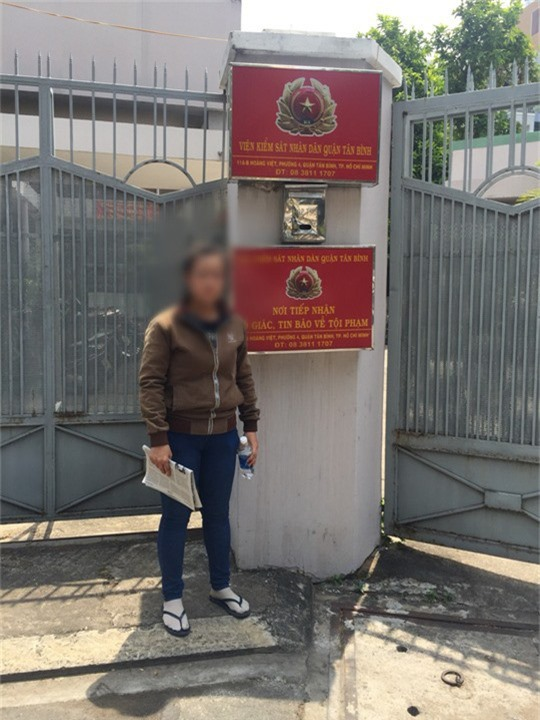 TAND quận Tân Bình bồi thường 400 triệu đồng cho 1 phụ nữ - Ảnh 1.