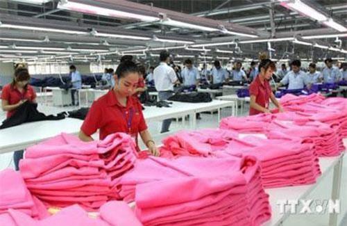 Để ổn định tại thị trường Nhật Bản, doanh nghiệp dệt may Việt Nam phải tạo dựng được thương hiệu của riêng mình. Ảnh minh hoạ TTXVN