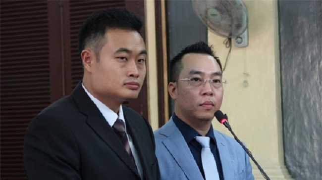 Ông Jerry Lim (áo đen) - đại diện Grab tại tòa (Ảnh: DL).