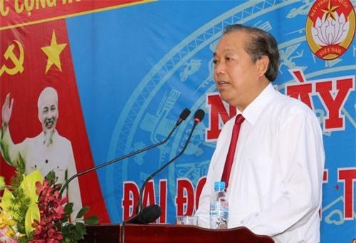 Phó Thủ tướng Trương Hòa Bình phát biểu tại Ngày hội Đại đoàn kết toàn dân tộc tại Khu phố Bình Quới A. Ảnh: VGP/Mạnh Hùng.