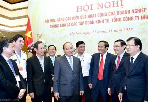Thủ tướng Nguyễn Xuân Phúc, Phó Thủ tướng Vương Đình Huệ, Phó Thủ tướng Trịnh Đình Dũng cùng các đại biểu dự Hội nghị. Ảnh: VGP/Quang Hiếu