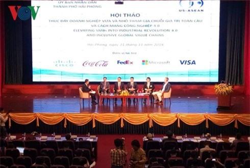 """Hội thảo """"Thúc đẩy doanh nghiệp vừa và nhỏ tham gia chuỗi giá trị toàn cầu và Cách mạng công nghiệp 4.0"""" diễn ra tại Hải Phòng hôm 21/11/2018. (Ảnh: VOV)"""