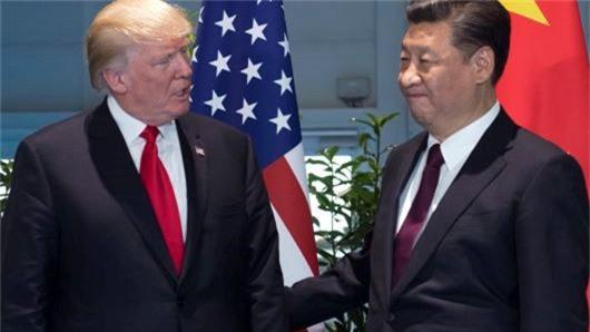 Tổng thống Mỹ Donald Trump (trái) và Chủ tịch Trung Quốc Tập Cận Bình trong ảnh chụp tại Hamburg (Đức) /// Ảnh: AFP