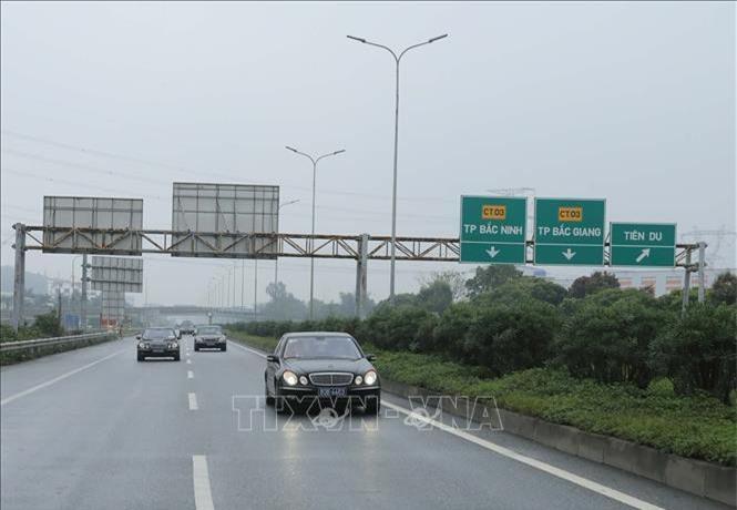 Đoàn xe đến Bắc Ninh (Ảnh:TTX)