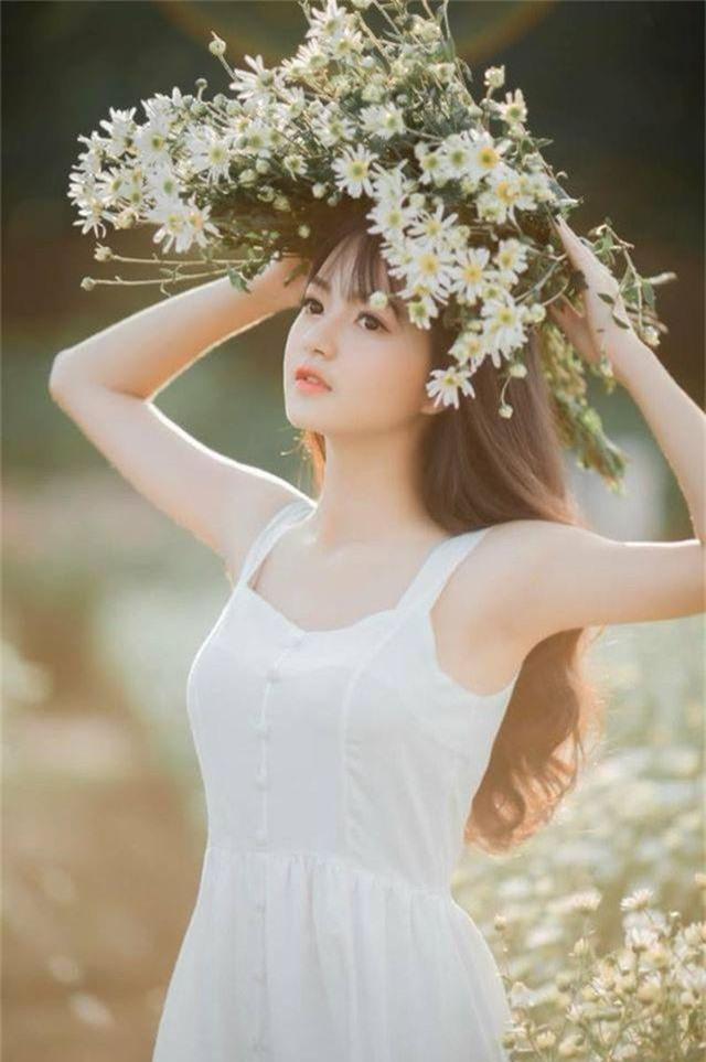 Nhan sắc xinh đẹp của thiếu nữ nổi tiếng nhờ một bức ảnh - 2