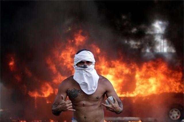 Ngoại trưởng Pompeo: Mỹ có thể can thiệp quân sự vào Venezuela nếu cần thiết - 2