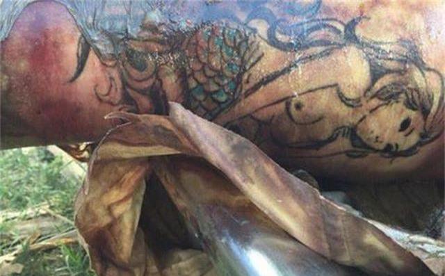 Truy tìm danh tính thi thể trôi sông có hình xăm nàng tiên cá - 1