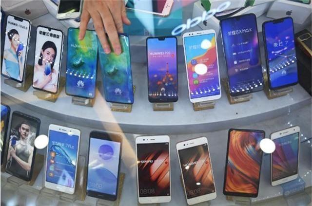 Huawei phản bác tin đồn cắt giảm sản xuất điện thoại thông minh - 1