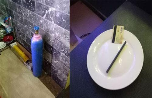 Bình khí N2O dùng để bơm bóng cười và dụng cụ sử dụng ma tuý được tìm thấy bên trong nhà hàng