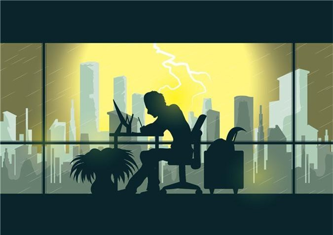man-working-late-in-office-overload