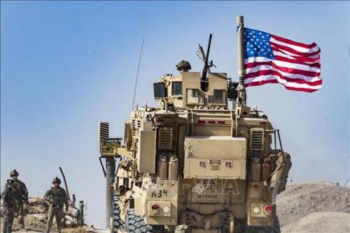 Binh sĩ Mỹ làm nhiệm vụ tại thị trấn Ras al-Ain, tỉnh Hasakeh, Syria, ngày 6/10/2019. (Ảnh: AFP/TTXVN)