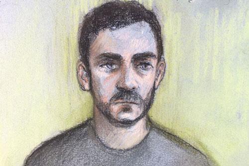 Đối tượng Maurice Robinson tại phiên tòa được tường thuật qua video. Ảnh: PA/TTXVN