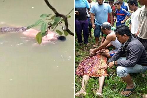 Người dân trục vớt xác nạn nhân sau khi được con cá sấu trả lại.