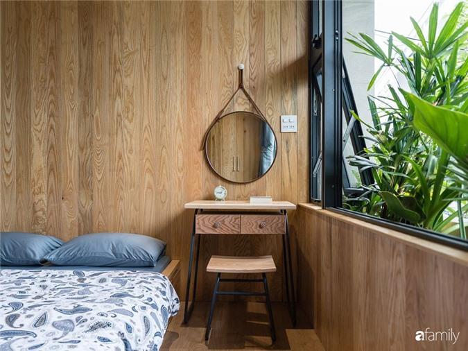 Ngôi nhà phố đẹp tinh tế với bản hòa tấu giữa vật liệu gỗ và ánh sáng ở Quy Nhơn dành cho gia đình 4 người - Ảnh 14.