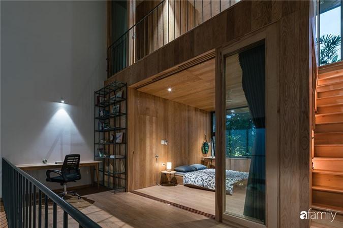 Ngôi nhà phố đẹp tinh tế với bản hòa tấu giữa vật liệu gỗ và ánh sáng ở Quy Nhơn dành cho gia đình 4 người - Ảnh 15.