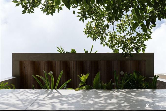 Ngôi nhà phố đẹp tinh tế với bản hòa tấu giữa vật liệu gỗ và ánh sáng ở Quy Nhơn dành cho gia đình 4 người - Ảnh 4.