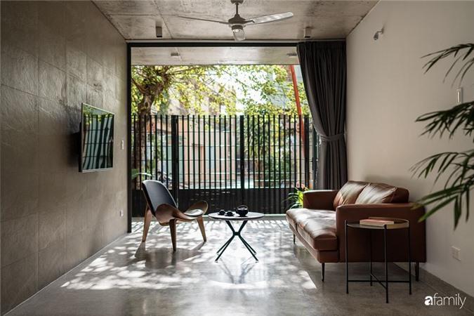 Ngôi nhà phố đẹp tinh tế với bản hòa tấu giữa vật liệu gỗ và ánh sáng ở Quy Nhơn dành cho gia đình 4 người - Ảnh 7.