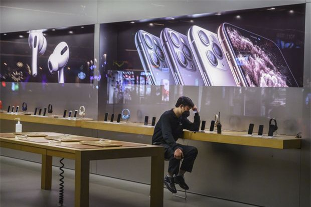 Apple đóng cửa toàn bộ cửa hàng và văn phòng tại Trung Quốc - Ảnh 1.