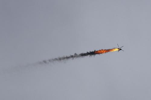 Trực thăng Mi-8 của Không quân Syria bị bắn hạ. Ảnh: Regnum.