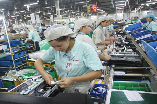 ịch bệnh tiếp tục ảnh hưởng tới sản xuất - kinh doanh của các doanh nghiệp FDI. Trong ảnh: Nhà máy của Canon tại Khu công nghiệp Bắc Thăng Long (Hà Nội)