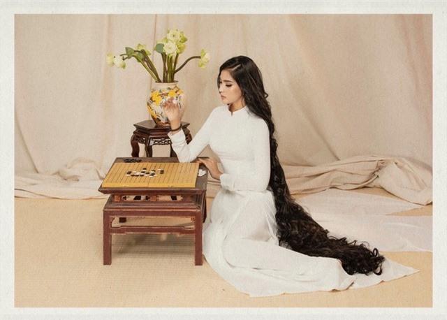 Á hậu Trương Thị May khoe bộ ảnh công-dung-ngôn-hạnh dịp 8/3 - Ảnh 5.