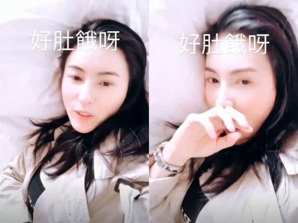 Người đẹp liên tục ngáp và cười nói rằng mình khá buồn ngủ - Ảnh: Sohu