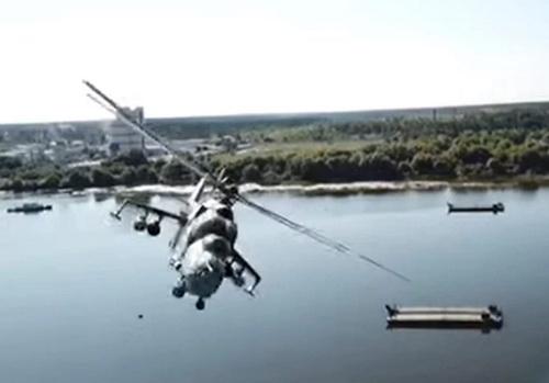 Hình ảnh chiếc trực thăng Mi-24 được ghi lại từ chính camera của chiếc UAV. Ảnh: TASS.