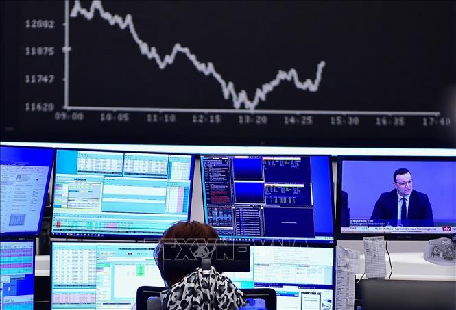 Ngày 25/3, chỉ số chứng khoán trên sàn giao dịch Frankfurt (Đức) nhảy vọt 3,5%. Ảnh: THX/TTXVN