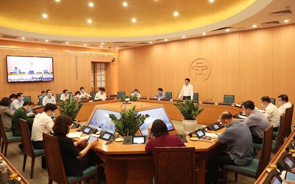Chủ tịch Nguyễn Đức Chung phát biểu chỉ đạo tại cuộc họp sáng 25/3/2020.