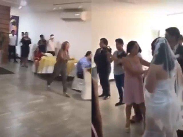 Cô gái xông vào đám cưới làm loạn và đánh cô dâu.