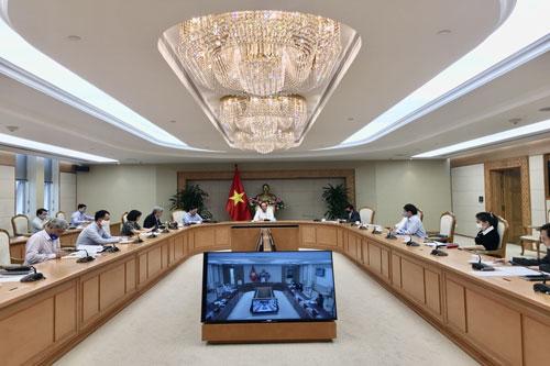 Tổ công tác của Thủ tướng làm việc với các cơ quan, hiệp hội doanh nghiệp, chiều 26/3. Ảnh: VGP/Hà Chính