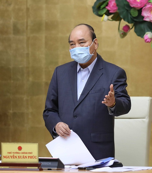 Thủ tướng Nguyễn Xuân Phúc chủ trì cuộc họp Thường trực Chính phủ chiều 27/3 - Ảnh: VGP/Quang Hiếu