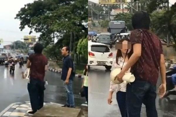 Chàng trai và cô gái cãi nhau dưới đường.