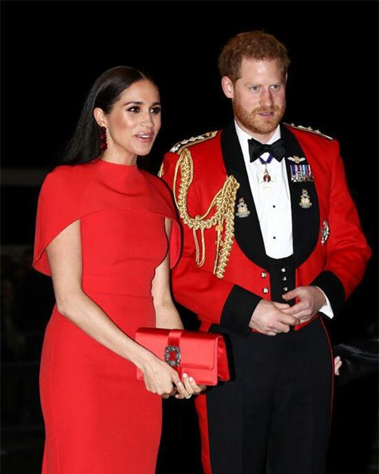 Vợ chồng Harry - Meghan dự sự kiện ở London tối 7/3. Ảnh: AFP.