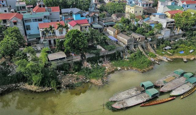 Hà Nội công bố tình trạng khẩn cấp sạt lở trên sông Bùi, sông Đáy - Ảnh 1.