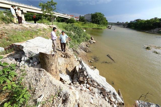 Hà Nội công bố tình trạng khẩn cấp sạt lở trên sông Bùi, sông Đáy - Ảnh 5.
