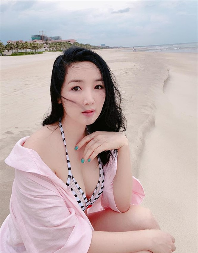 Hoa hậu Giáng My khoe vòng 1 gợi cảm với bikini  - ảnh 4