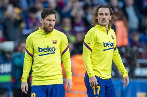 Messi và Griezmann (phải). Ảnh: Getty.