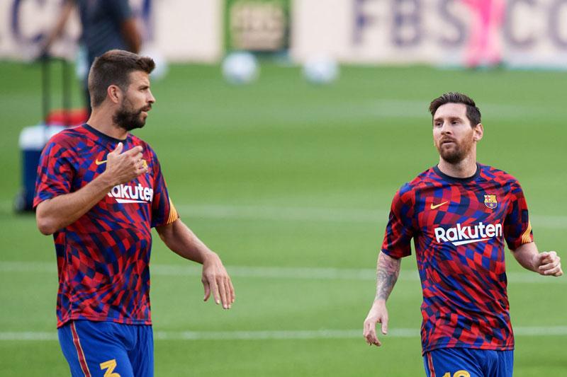 Pique và Messi.