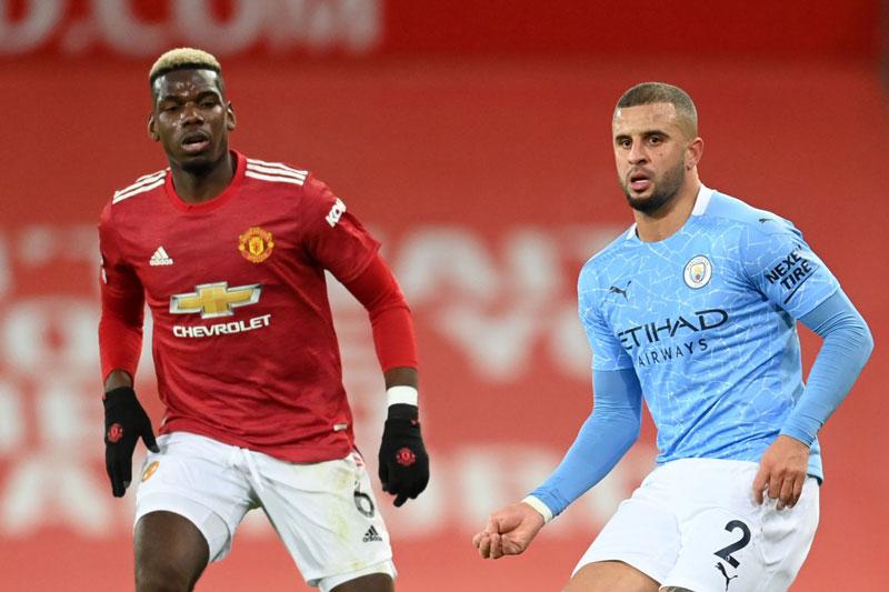 M.U (áo đỏ) và Man City