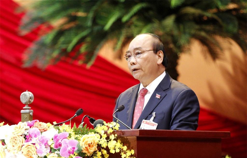 Đồng chí Nguyễn Xuân Phúc, Ủy viên Bộ Chính trị, Thủ tướng Chính phủ thay mặt Đoàn Chủ tịch đọc Diễn văn khai mạc Đại hội