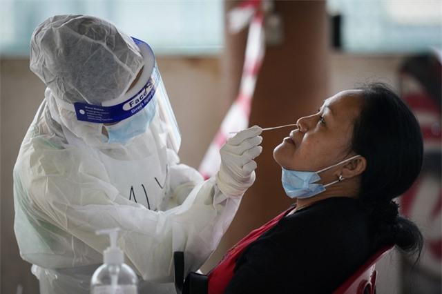 Hơn 108,9 triệu người mắc COVID-19, thế giới ghi nhận số ca nhiễm mới giảm nhiều nhất và lâu nhất - Ảnh 2.