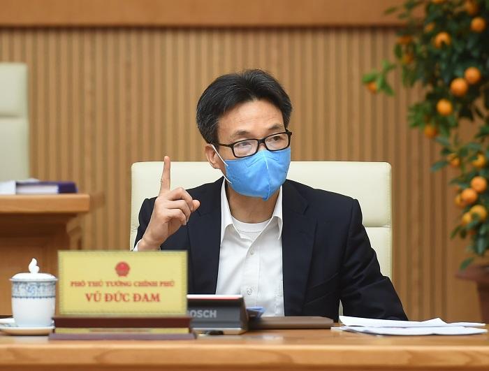 Phó Thủ tướng Chính phủ Vũ Đức Đam, Trưởng Ban Chỉ đạo quốc gia phòng chống dịch COVID-19 phát biểu tại cuộc họp.