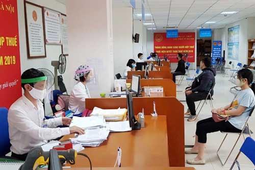 Cục Thuế Hà Nội vừa bảo đảm nhiệm vụ công tác vừa phòng, chống dịch Covid-19. Ảnh minh họa.