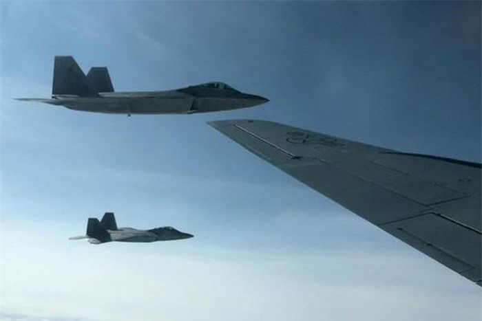 F-22 Raptor escorting Tu-142