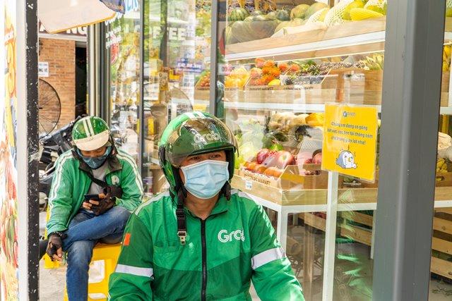 Grab Việt Nam tặng gói bảo hiểm PTI - Vững Tâm hỗ trợ đối tác tài xế Grab trong dịch Covid-19