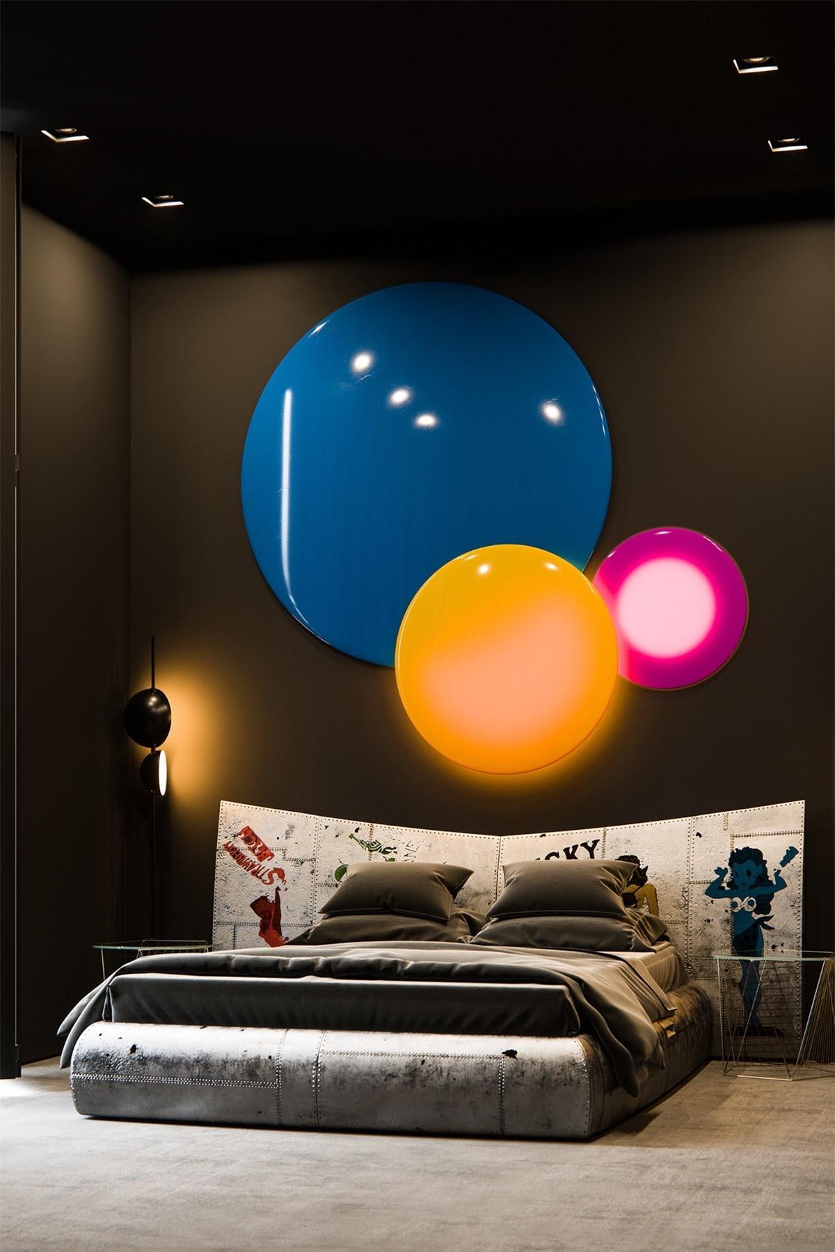Màu đen trở thành một phông nền hoàn hảo với các điểm nhấn màu sắc và chiếc giường độc đáo này.